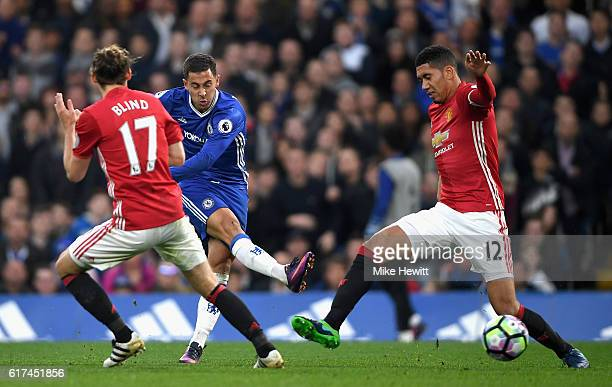Eden Hazard of Chelsea scores his sides third goal during the Premier League match between Chelsea and Manchester United at Stamford Bridge on...