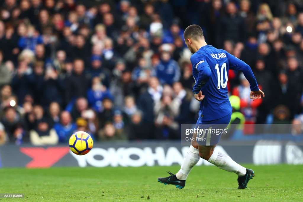 Eden Hazard of Chelsea scores his sides third goal from the penalty spot during the Premier League match between Chelsea and Newcastle United at Stamford Bridge on December 2, 2017 in London, England.