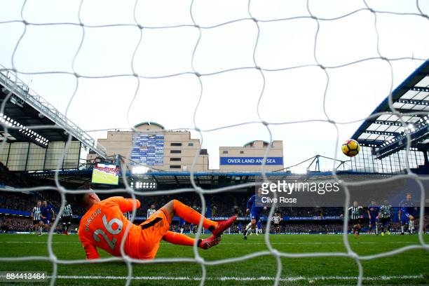 Eden Hazard of Chelsea scores his sides third goal from the penalty spot past Karl Darlow of Newcastle United during the Premier League match between...