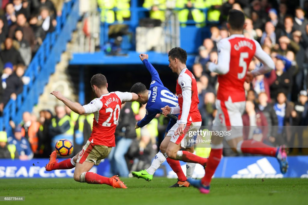 Eden Hazard of Chelsea scores his team's second goal during the Premier League match between Chelsea and Arsenal at Stamford Bridge on February 4, 2017 in London, England.