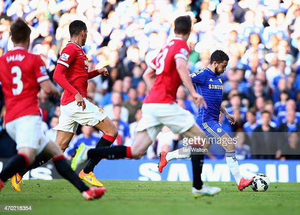 Eden Hazard of Chelsea scores the opening goal during the Barclays Premier League match between Chelsea and Manchester United at Stamford Bridge on...
