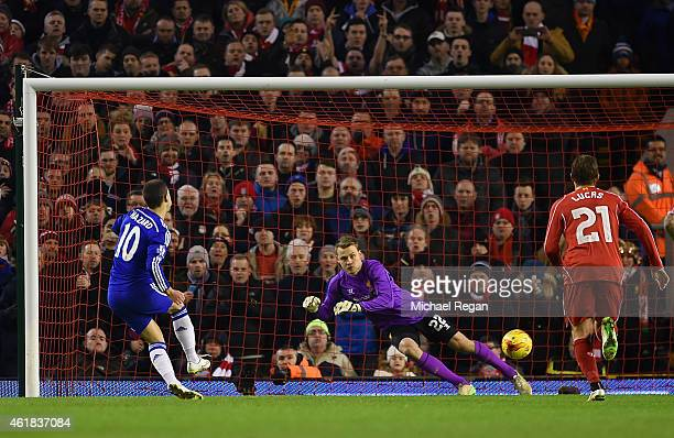 Eden Hazard of Chelsea scores the opening goal past Simon Mignolet of Liverpool from the penalty spot during the Capital One Cup SemiFinal first leg...