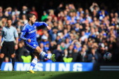 Eden Hazard of Chelsea scores their third goal from the penalty spot during the Barclays Premier League match between Chelsea and Arsenal at Stamford...