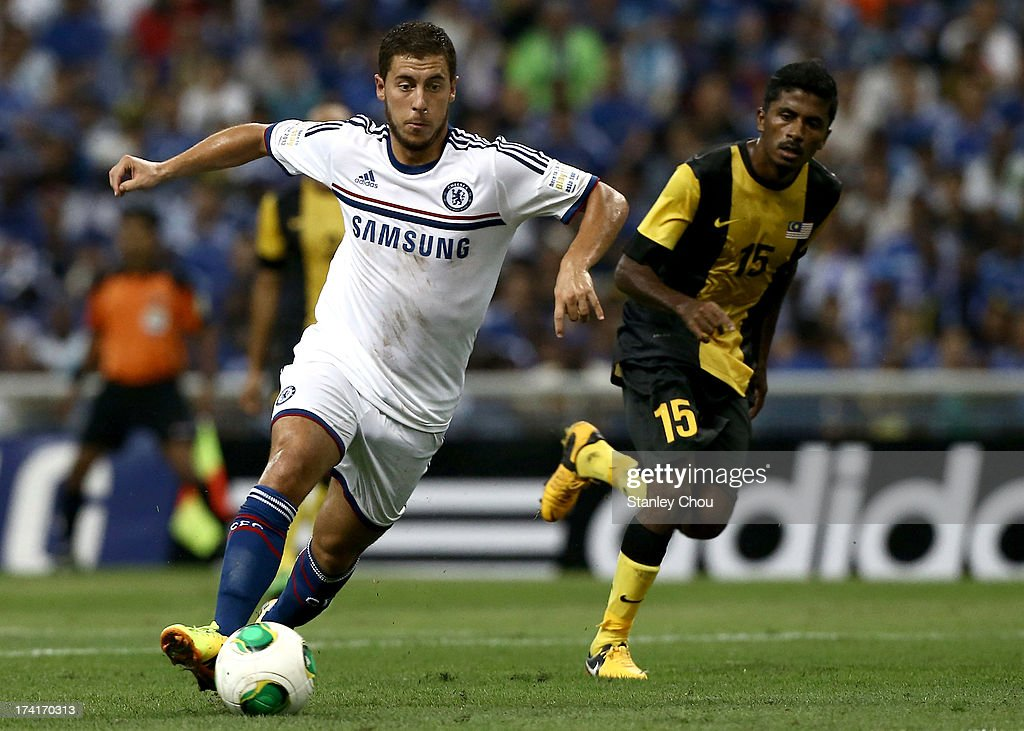 <a gi-track='captionPersonalityLinkClicked' href=/galleries/search?phrase=Eden+Hazard&family=editorial&specificpeople=5539543 ng-click='$event.stopPropagation()'>Eden Hazard</a> of Chelsea shields the ball away from K.Gurusamy of Malaysia during the match between Chelsea and Malaysia XI on July 21, 2013 in Kuala Lumpur, Malaysia.