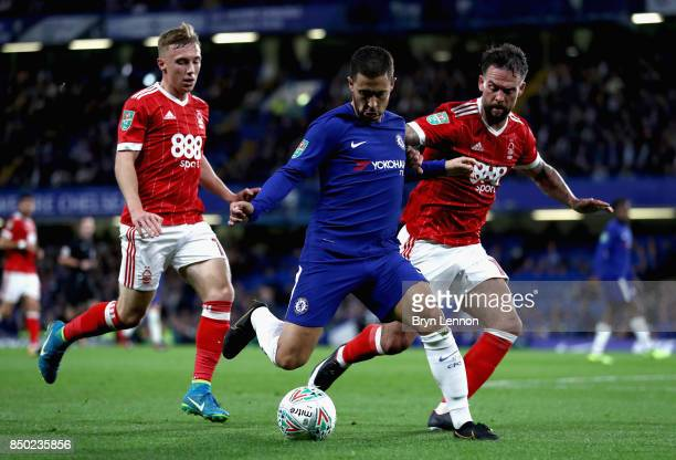 Eden Hazard of Chelsea shoots while under pressure from Danny Fox of Nottingham Forest during the Carabao Cup Third Round match between Chelsea and...