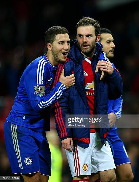 Eden Hazard of Chelsea speaks with Juan Mata of Manchester United after the Barclays Premier League match between Manchester United and Chelsea at...