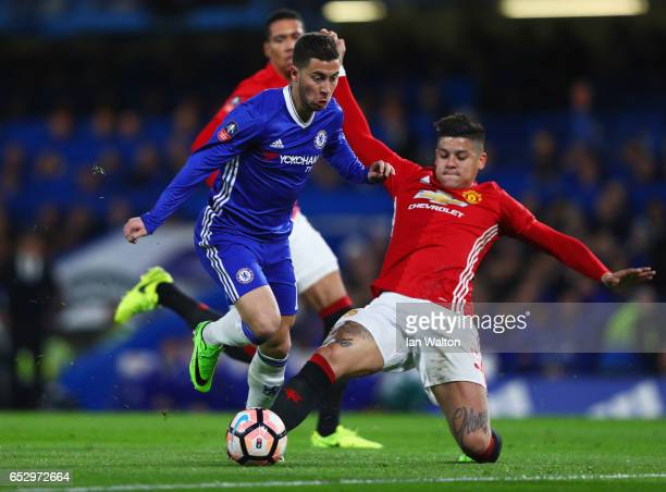 Eden Hazard of Chelsea takes on Marcos Rojo of Manchester United during The Emirates FA Cup QuarterFinal match between Chelsea and Manchester United...