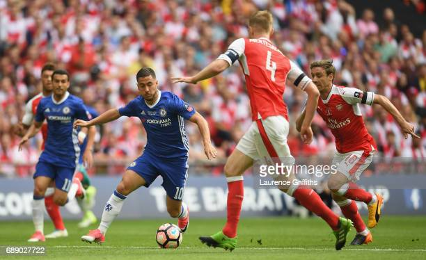 Eden Hazard of Chelsea takes on the Chelsea defence during The Emirates FA Cup Final between Arsenal and Chelsea at Wembley Stadium on May 27 2017 in...
