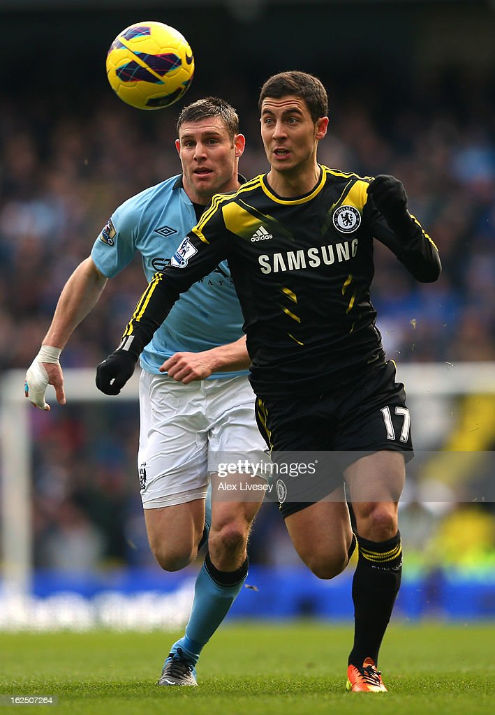 Eden Hazard of Chelsea takes the ball past James Milner of Manchester City during the Barclays Premier League match between Manchester City and Chelsea at Etihad Stadium on February 24, 2013 in Manchester, England.