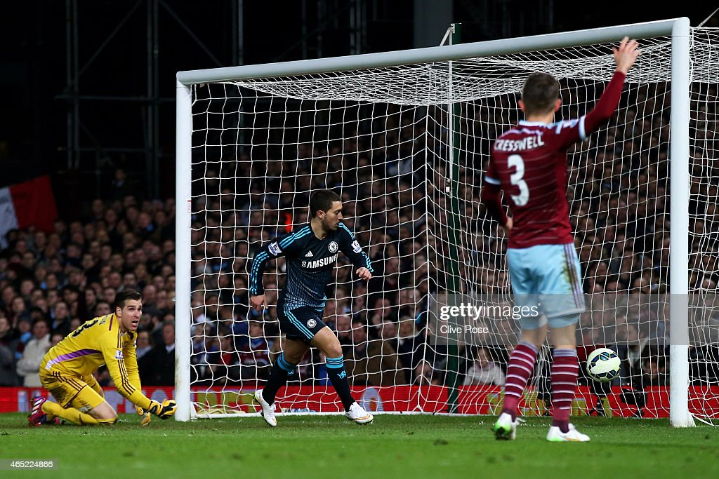 Eden Hazard of Chelsea turns away to celebrate after scoring the opening goal during the Barclays Premier League match between West Ham and Chelsea at the Boleyn Ground on March 4, 2015 in London, England.
