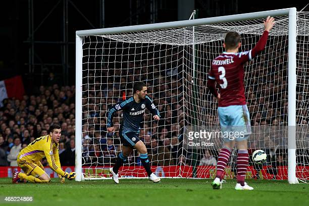 Eden Hazard of Chelsea turns away to celebrate after scoring the opening goal during the Barclays Premier League match between West Ham and Chelsea...