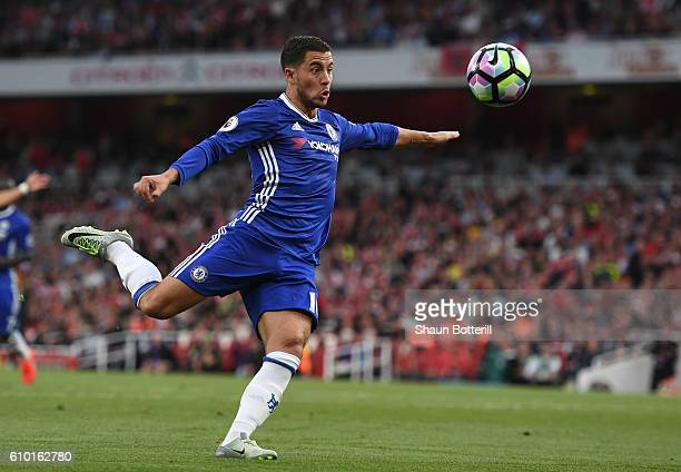 Eden Hazard of Chelsea volleys during the Premier League match between Arsenal and Chelsea at the Emirates Stadium on September 24 2016 in London...