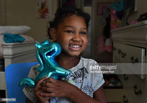 Eden Oyelola holds a unicorn coin bank that was given to her by the MakeaWish Foundation Little 6yearold Eden Oyelola has a brain tumor and she is...