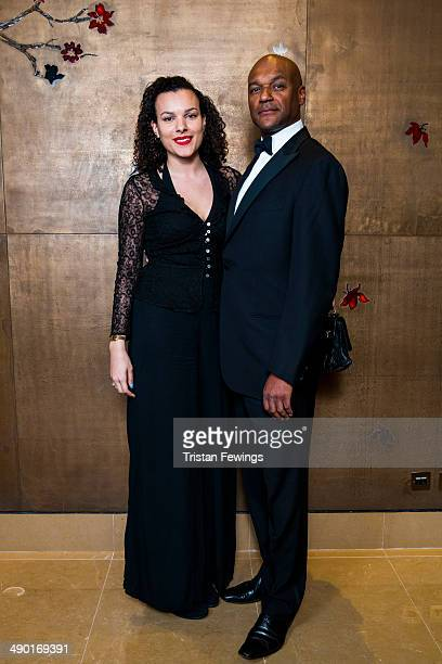 Eden Salmon and Colin Salmon attend the premiere for 'Nat King Cole Afraid Of the Dark' at The Mayfair Hotel on May 13 2014 in London England