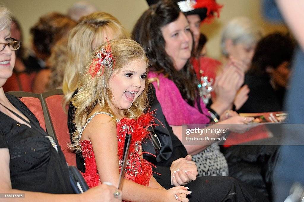 Eden Wood reacts after being announced as the winner of the Entertainer of the Year Award at the First Annual Youth Excellence Awards at Holiday Inn...