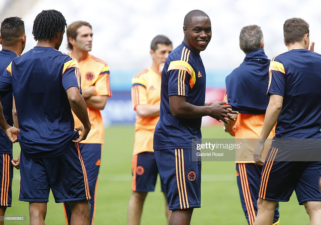 Eder Alvarez Balanta of Colombia smiles during the Colombia training session before the 2014 FIFA World Cup Group C match between Greece and Colombia at Mineirao Stadium on June 13, 2014 in Belo Horizonte, Brazil..