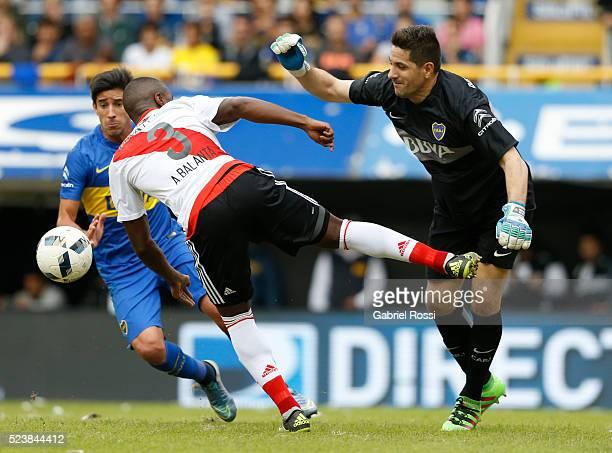 Eder Alvarez Balanta of River Plate fights for the ball with Agustin Orion goalkeeper of Boca Juniors during a match between Boca Juniors and River...