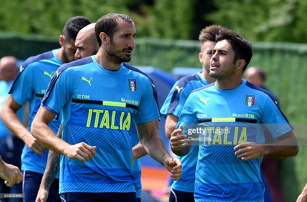 Eder (R) and <a gi-track='captionPersonalityLinkClicked' href=/galleries/search?phrase=Giorgio+Chiellini&family=editorial&specificpeople=605793 ng-click='$event.stopPropagation()'>Giorgio Chiellini</a> of Italy chat during the training session at 'Bernard Gasset' Training Center on June 29, 2016 in Montpellier, France.