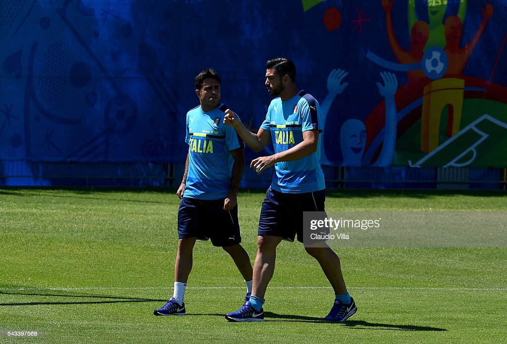 Eder (L) and <a gi-track='captionPersonalityLinkClicked' href=/galleries/search?phrase=Graziano+Pelle&family=editorial&specificpeople=2333390 ng-click='$event.stopPropagation()'>Graziano Pelle</a> of Italy chat during the training session at 'Bernard Gasset' Training Center on June 28, 2016 in Montpellier, France.
