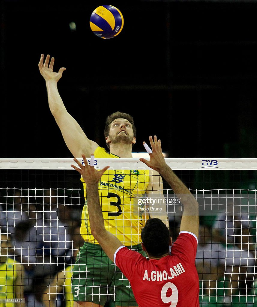 Eder Carbonera of Brazil spikes the ball as Adel Gholami of Iran blocks during the FIVB World League Final Six match between Brazil and Iran at Mandela Forum on July 18, 2014 in Florence, Italy.