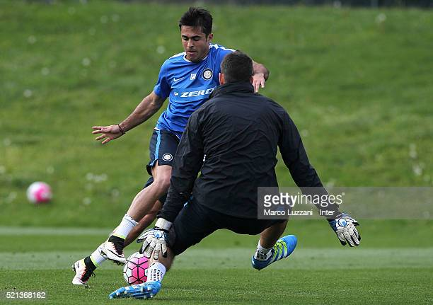 Eder Citadin Martins is challenged by Samir Handanovic during the FC Internazionale training session at the club's training ground on April 15 2016...