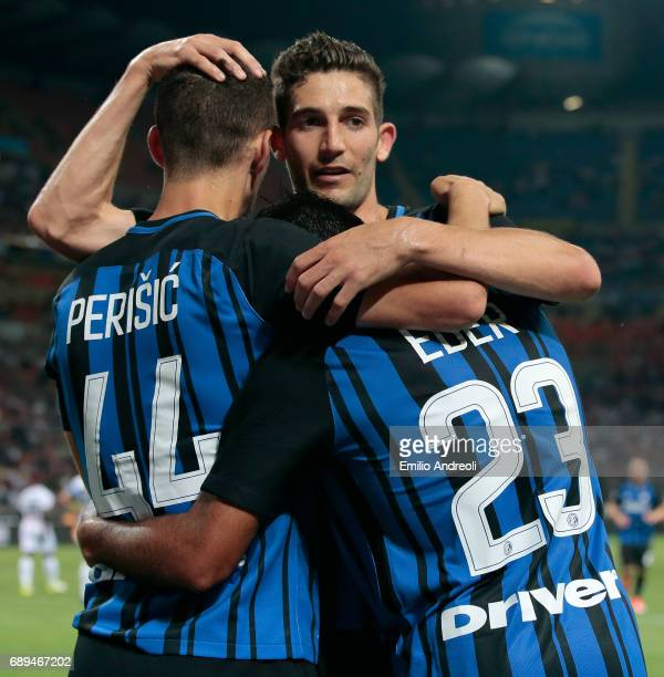 Eder Citadin Martins of FC Internazionale Milano celebrates his second goal with his teammates Ivan Perisic and Roberto Gagliardini during the Serie...