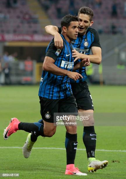 Eder Citadin Martins of FC Internazionale Milano celebrates with his teammate Roberto Gagliardini after scoring the opening goal during the Serie A...