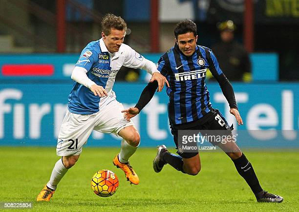 Eder Citadin Martins of FC Internazionale Milano competes for the ball with Nicolas Frey of AC Chievo Verona during the Serie A match between FC...
