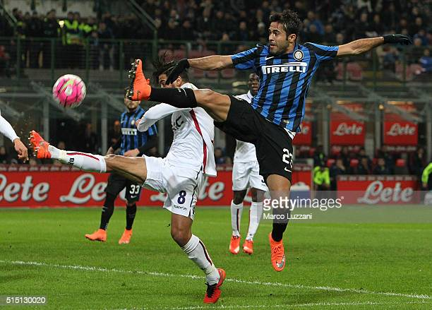 Eder Citadin Martins of FC Internazionale Milano competes for the ball with Saphir Sliti Taider of Bologna FC during the Serie A match between FC...