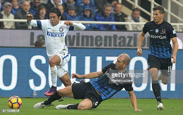 Eder Citadin Martins of FC Internazionale Milano is challenged by Andrea Masiello of Atalanta BC during the Serie A match between Atalanta BC and FC...