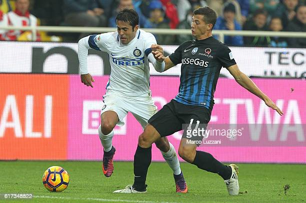 Eder Citadin Martins of FC Internazionale Milano is challenged by Remo Freuler of Atalanta BC during the Serie A match between Atalanta BC and FC...