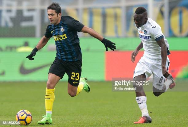 Eder Citadin Martins of FC Internazionale Milano is challenged by Assane Diousse of Empoli FC during the Serie A match between FC Internazionale and...