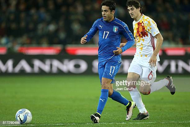 Eder Citadin Martins of Italy and Mikel San Jose of Spain in action during the international friendly match between Italy and Spain at Stadio Friuli...