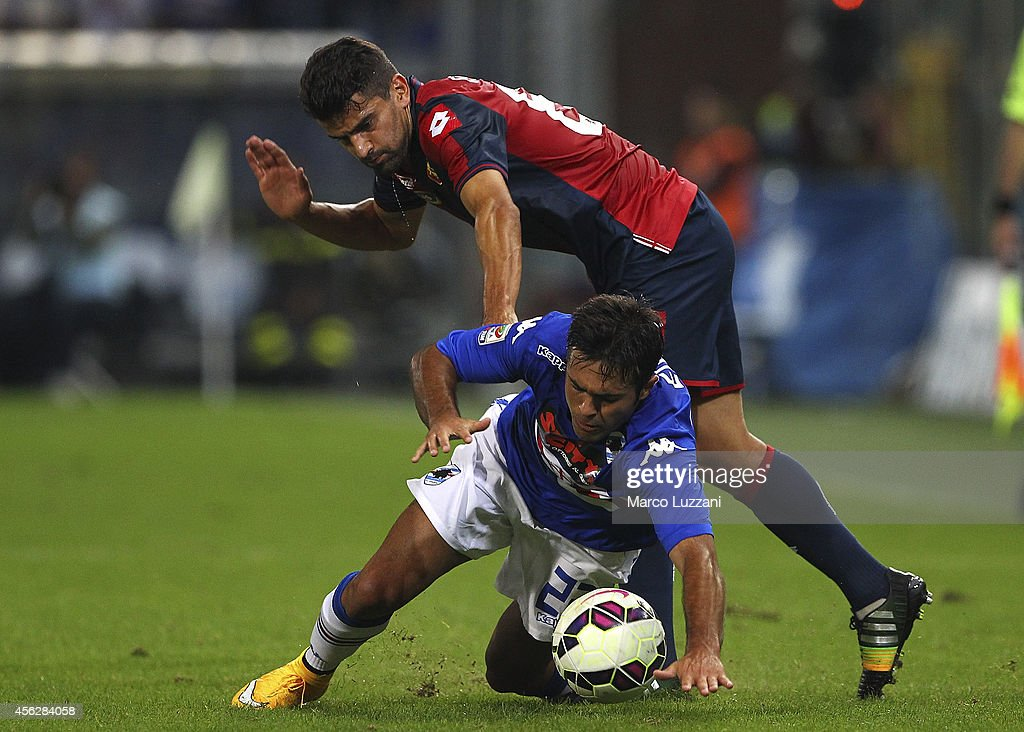 Eder Citadin Martins of UC Sampdoria is challenged by <a gi-track='captionPersonalityLinkClicked' href=/galleries/search?phrase=Tomas+Rincon&family=editorial&specificpeople=1009045 ng-click='$event.stopPropagation()'>Tomas Rincon</a> of Genoa CFC during the Serie A match between Genoa CFC and UC Sampdoria at Stadio Luigi Ferraris on September 28, 2014 in Genoa, Italy.