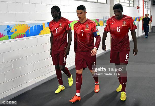 Eder Cristiano Ronaldo and William Carvalho of Portugal walk in the tunnel after the half time during the 2014 FIFA World Cup Brazil Group G match...