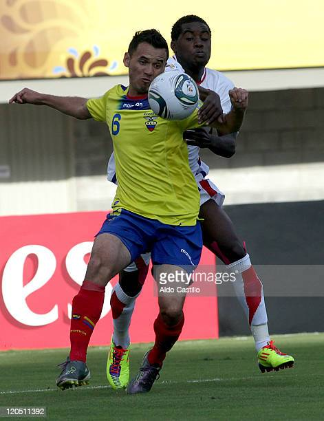 Eder Fuertes from Ecuador fights for the ball with Joel Campbell from Costa Rica during a match of Group C between Ecuador and Costa Rica as part of...