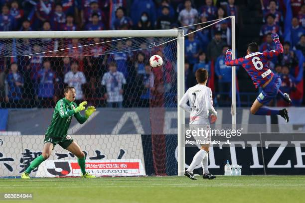 Eder Lima of Ventforet Kofu scores his side's second goal past Gu Sung Yun of Consadole Sapporo during the JLeague J1 match between Ventforet Kofu...
