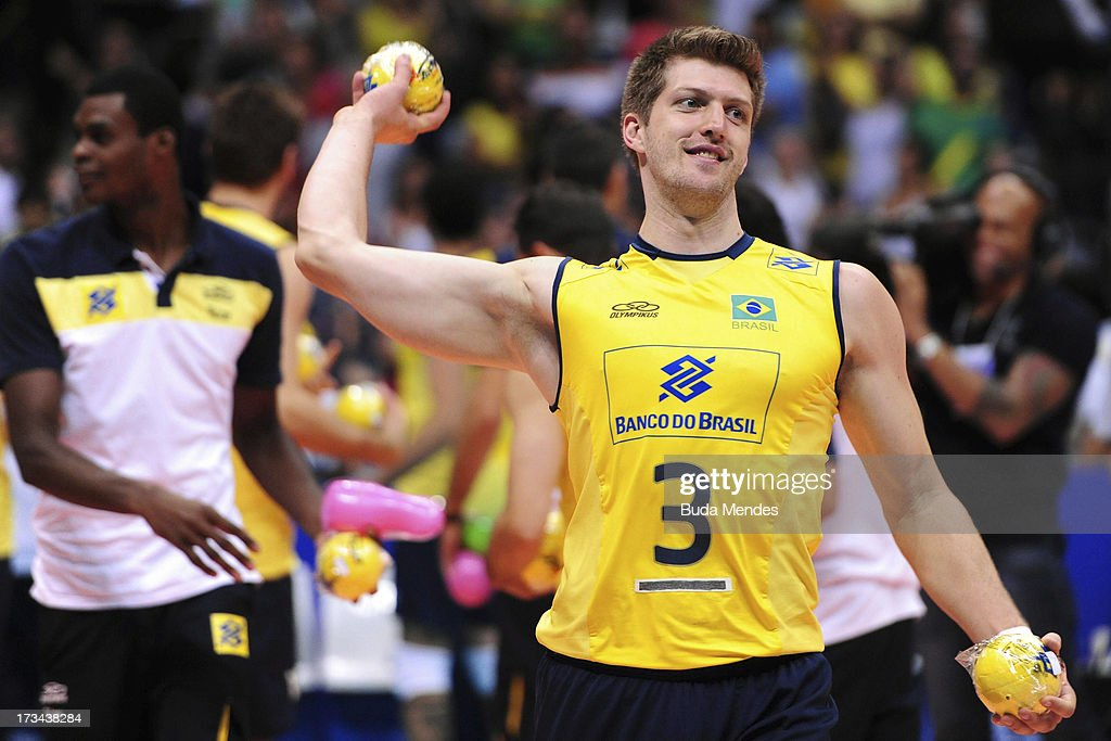 Eder of Brazil celebrates the victory after a match between Brazil and USA as part of the FIVB Volleyball World League 2013 at the Maracanazinho gymnasium on July 14, 2013 in Rio de Janeiro, Brazil.