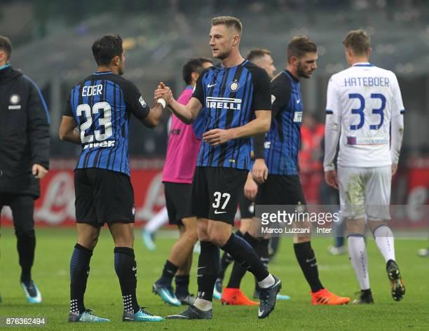 Eder of FC Internazionale and Milan Skriniar of FC Internazionale celebrate the win at the end of the Serie A match between FC Internazionale and...