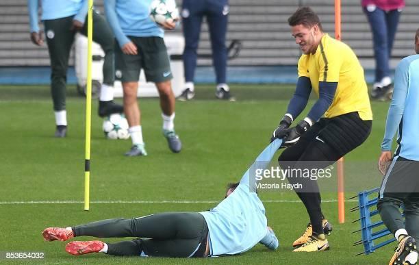 Ederson Moraes drags Bernardo Silva during the Manchester City training session on September 25 2017 in Manchester England