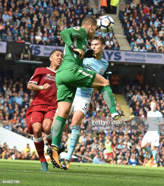 Ederson Moraes of Manchester City Heads Clear during the Premier League match between Manchester City and Liverpool at Etihad Stadium on September 9...