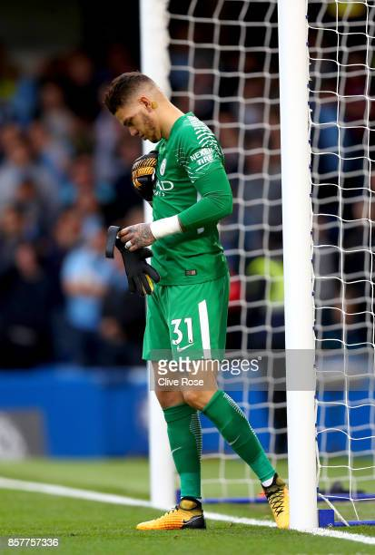 Ederson Moraes of Manchester City in action during the Premier League match between Chelsea and Manchester City at Stamford Bridge on September 30...