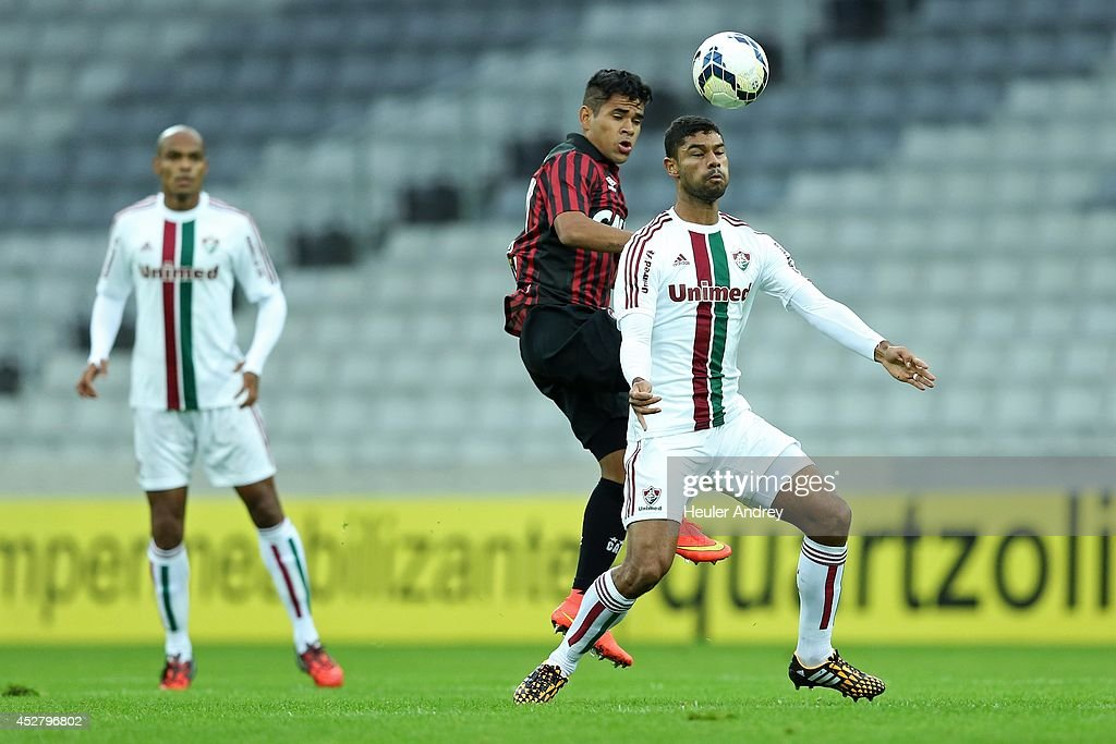 Ederson of Atletico-PR competes for the ball with Gum of Fluminense during the match between Atletico-PR and Fluminense for the Brazilian Series A 2014 at Arena da Baixada on July 27, 2014 in Curitiba, Brazil.
