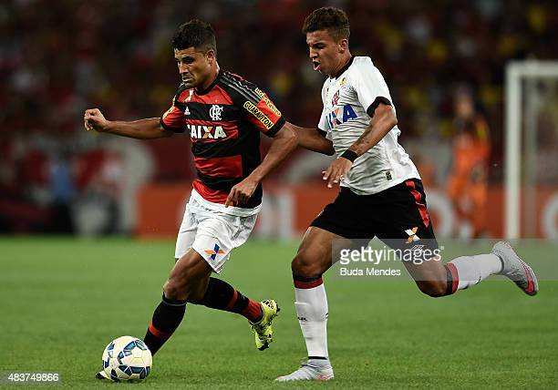 Ederson of Flamengo battles for the ball with Crysan of Atletico Paranaense during a match between Flamengo and Atletico Paranaense as part of...