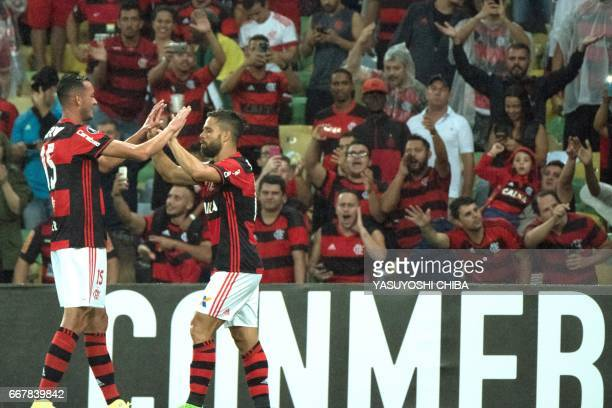 Ederson of Flamengo celebrates with Rever after the second goal against Atletico Paranaense during theis 2017 Copa Libertadores football match at...