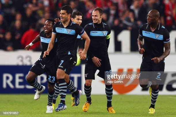 Ederson of Lazio celebrates his team's first goal with team mates during the UEFA Europa League round of 16 first leg match between VfB Stuttgart and...