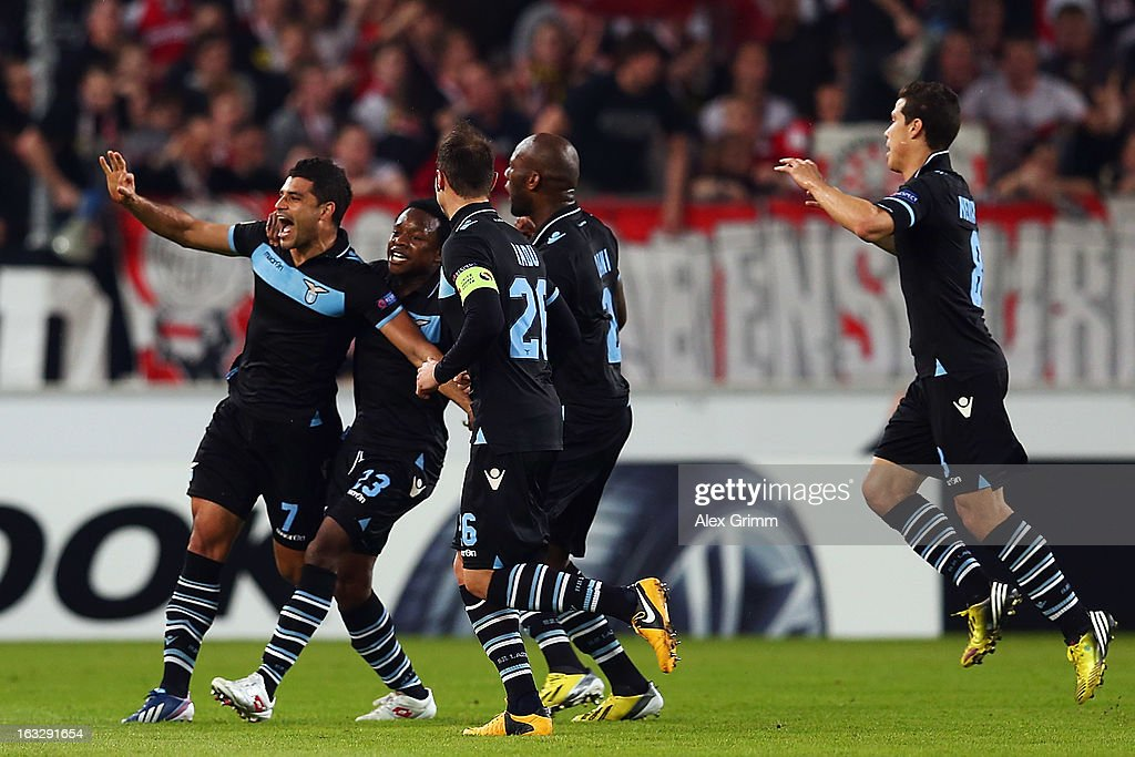 Ederson of Lazio celebrates his team's first goal with team mates during the UEFA Europa League round of 16 first leg match between VfB Stuttgart and Lazio at Mercedes-Benz Arena on March 7, 2013 in Stuttgart, Germany.