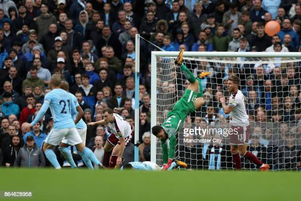 Ederson of Manchester City attempts to collect the ball during the Premier League match between Manchester City and Burnley at Etihad Stadium on...
