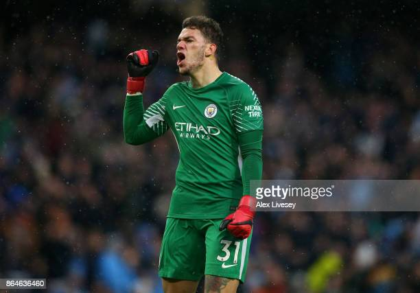 Ederson of Manchester City celebrates as Leroy Sane of Manchester City scores their third goal during the Premier League match between Manchester...