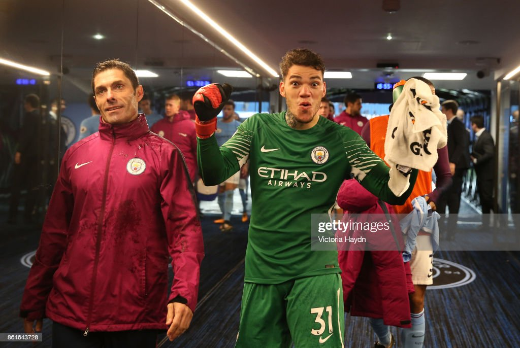Ederson of Manchester City celebrates his side's win following the Premier League match between Manchester City and Burnley at Etihad Stadium on October 21, 2017 in Manchester, England.